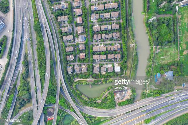 aerial view of overpass and residential community - liyao xie stock pictures, royalty-free photos & images