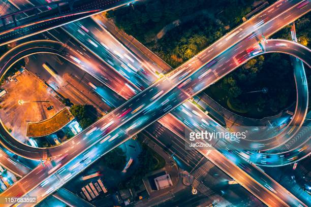 aerial view of overpass at night - street light stock pictures, royalty-free photos & images