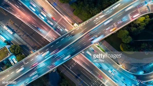 aerial view of overpass at night - prosperity stock pictures, royalty-free photos & images
