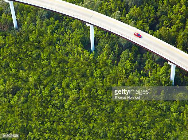 Aerial View of overpass with red car