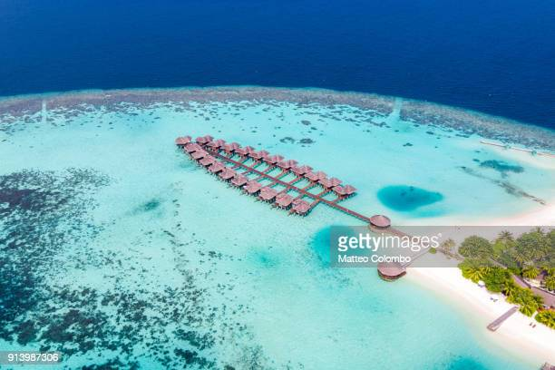 aerial view of overwater bungalows in the maldives - bungalow stock pictures, royalty-free photos & images