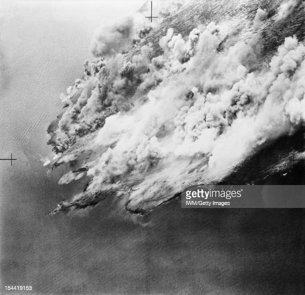The Campaign In Sicily 1943 Pantelleria and Lampedusa May June 1943 Aerial view of Pantelleria wreathed in smoke from bursting bombs during the...