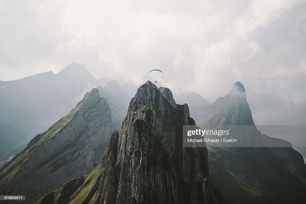 Aerial View Of Paraglider Over Mountain Range : Stock Photo