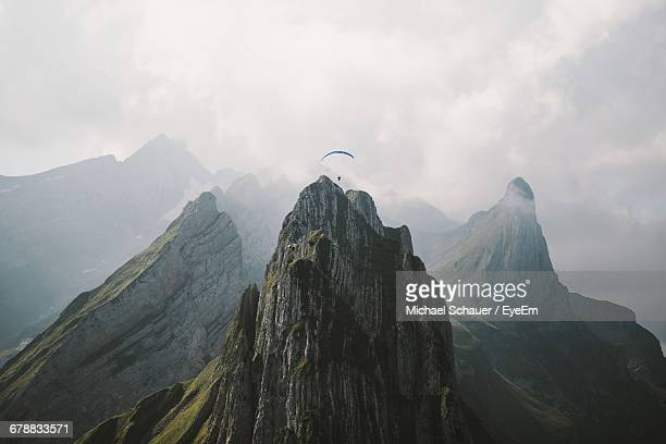 aerial view of paraglider over mountain range - tall high stock photos and pictures