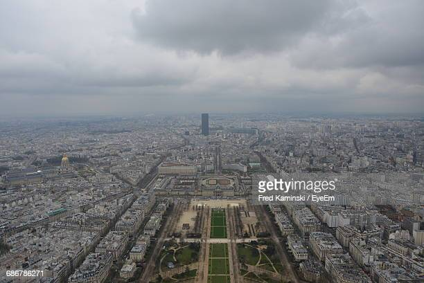 Aerial View Of Paris Cityscape Against Cloudy Sky