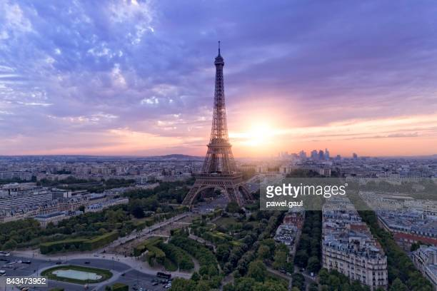 aerial view of paris skyline with eiffel tower during sunset - eiffel tower stock photos and pictures