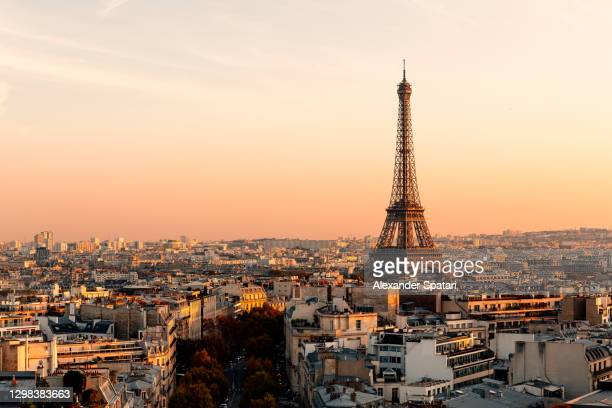 aerial view of paris streets and eiffel tower at sunset, france - paris france stock pictures, royalty-free photos & images