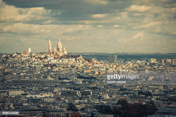 Aerial view of Paris with Sacre Coeur with cloudy sky in day