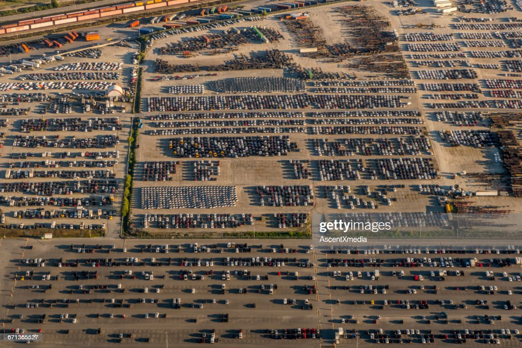 Aerial view of parked cars and train track : Stock Photo