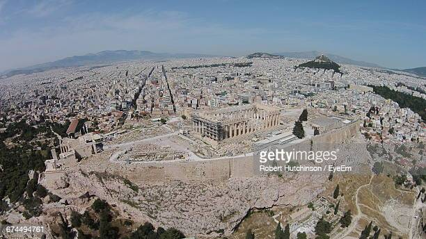 Aerial View Of Parthenon On Acropolis Hill By Residential District Against Sky