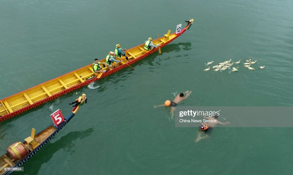 Aerial view of participants chasing ducks on the Jialing ...