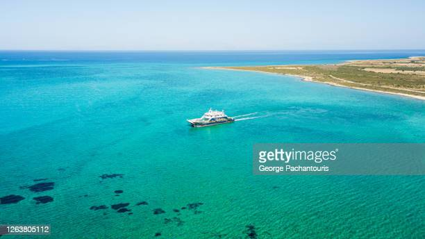 aerial view of passenger ferry on tropical waters - ferry stock pictures, royalty-free photos & images