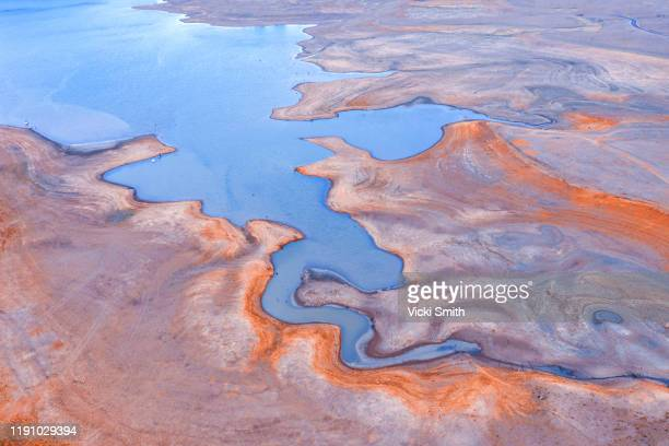 aerial view of patterns over water and dry drought land markings as the water recedes - estuary stock pictures, royalty-free photos & images
