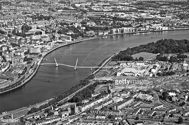 aerial view of peace bridge over river foyle amidst city - river foyle stock pictures, royalty-free photos & images