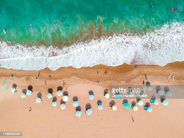 aerial view of people at beach - bali stock pictures, royalty-free photos & images