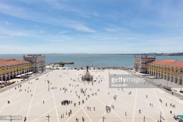 aerial view of people at praca do comrcio against sky, lisbon, portugal - praça do comércio imagens e fotografias de stock