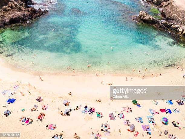 aerial view of people at the beach - lanzarote stock pictures, royalty-free photos & images