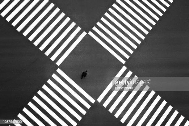 aerial view of people crossing a big intersection in ginza, tokyo, japan - intersection stock pictures, royalty-free photos & images