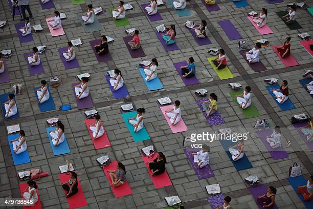 Aerial view of people doing yoga during a gathering event of yoga show on July 5 2015 in Hanzhong Shaanxi Province of China Nearly 300 people do yoga...