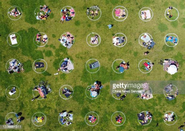 Aerial view of people lying in social distancing circles at Dolores Park amid the coronavirus outbreak on Memorial Day weekend on May 24 2020 in San...