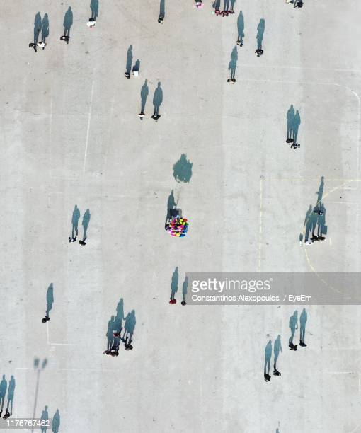 aerial view of people on street in city - people stock pictures, royalty-free photos & images