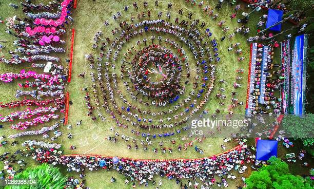 Aerial view of people performing Lusheng dance to welcome the Miao New Year on November 21, 2020 in Liuzhou, Guangxi Zhuang Autonomous Region of...