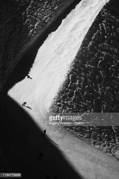 Aerial View Of People Skiing On Snow