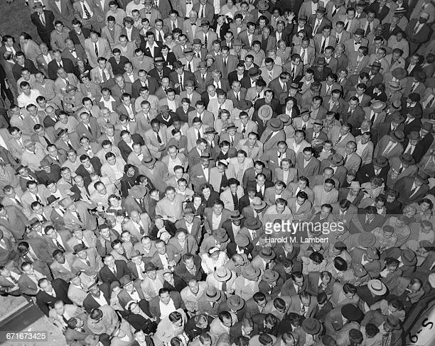 aerial view of people standing together - number of people stock pictures, royalty-free photos & images