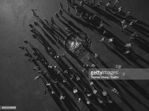 aerial view of people surrounding bonfire - surrounding stock pictures, royalty-free photos & images
