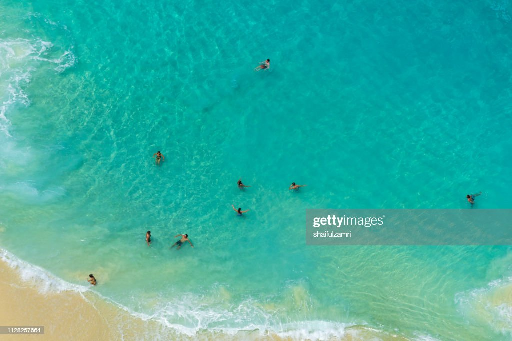 Aerial view of people swimming in the transparent turquoise sea. : Stock Photo