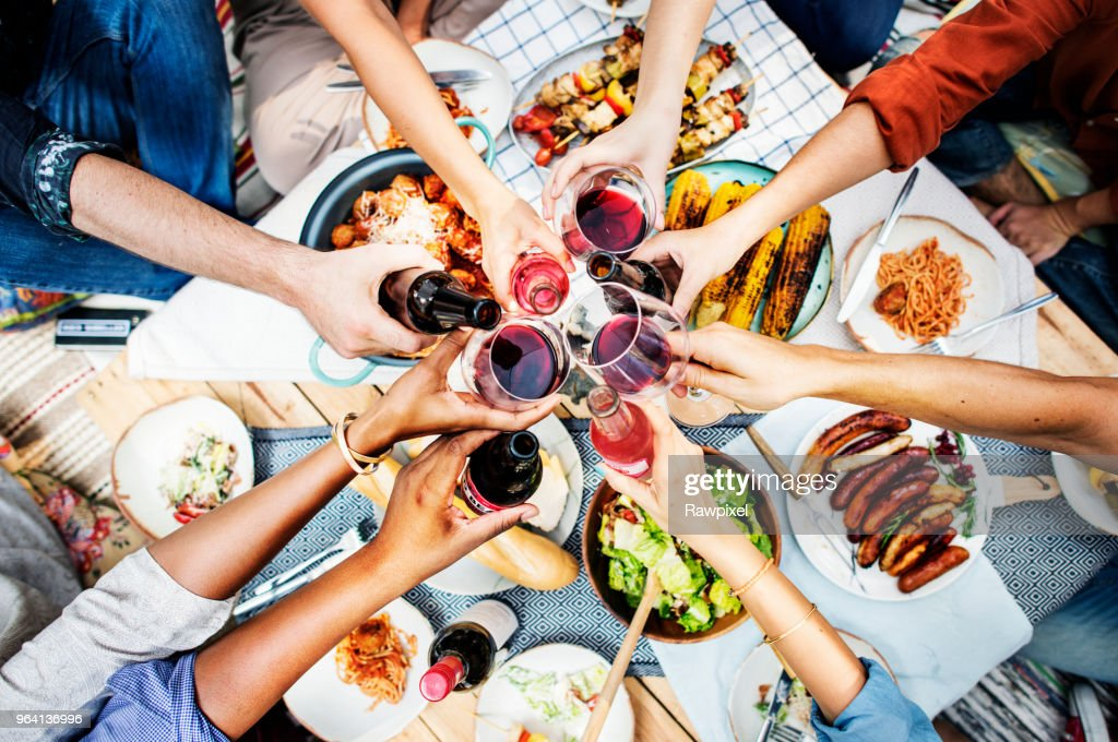 Aerial view of people toasting together : Stock Photo