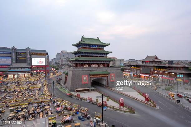 Aerial view of people visiting a night market at Drum Tower Square on June 8, 2020 in Kaifeng, Henan Province of China.