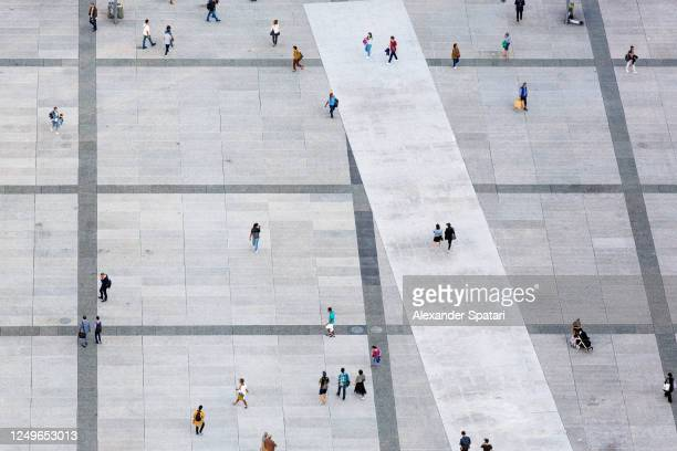 aerial view of people walking at the city square - courtyard stock pictures, royalty-free photos & images