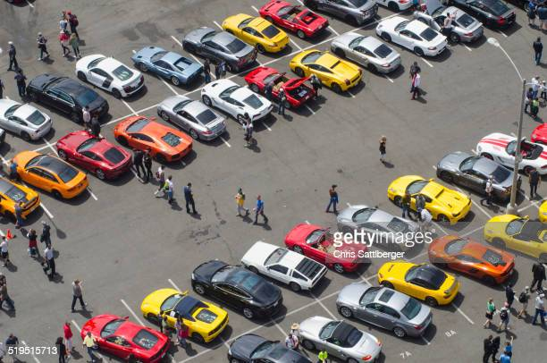 aerial view of people walking in parking lot - motor show stock pictures, royalty-free photos & images