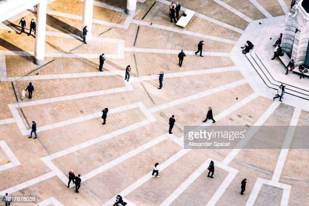 aerial view of people walking on the town square - drone point of view stock pictures, royalty-free photos & images