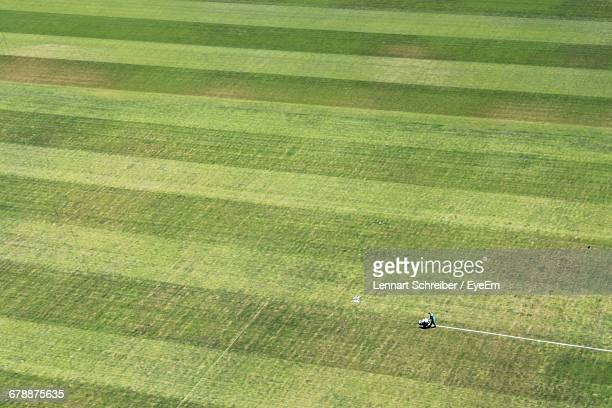 aerial view of person making yard lines at soccer field - ground staff stock pictures, royalty-free photos & images