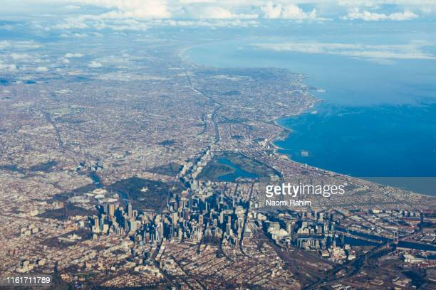 aerial view of perth cbd, surrounding suburbs and the indian ocean, on a sunny day - urban sprawl stock pictures, royalty-free photos & images