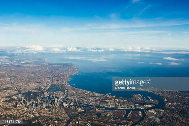 aerial view of perth cbd, swan river, surrounding suburbs and the indian ocean on a sunny day - perth australia stock pictures, royalty-free photos & images