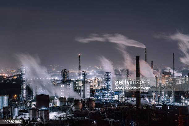 aerial view of petrochemical plant and oil refinery industry at night - beijing stock pictures, royalty-free photos & images