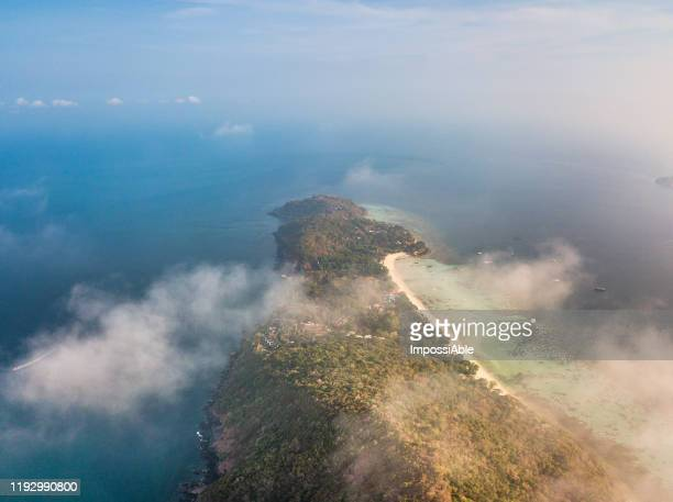 aerial view of phi phi don island with the misty in the morning, andaman sea , krabi, thailand - impossiable stock pictures, royalty-free photos & images