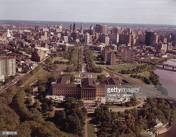 Aerial view of Philadelphia looks southeast from across the Schuylkill River over the Philadelphia Museum of Art down the broad treelined expanse of...