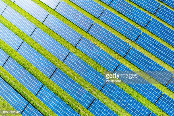 aerial view of photovoltaic plant - sustainability stock photos and pictures