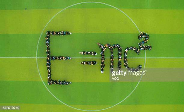 Aerial view of physics graduates posing to form the formula 'E=mc2' for graduation pictures at Beihua University on June 17 2016 in Jilin City Jilin...