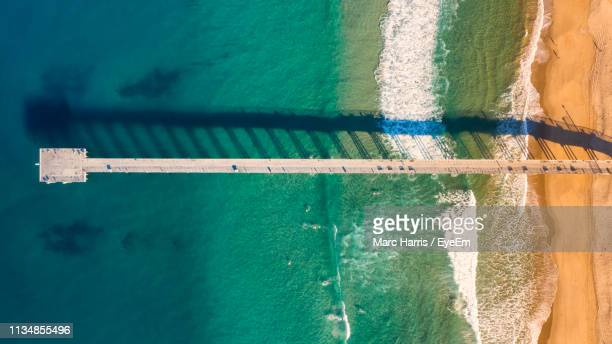 aerial view of pier at beach over sea - hermosa beach stock pictures, royalty-free photos & images