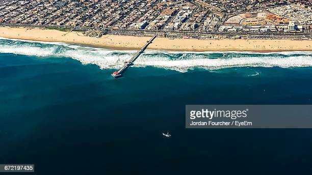 aerial view of pier at huntington beach by city - huntington beach stock pictures, royalty-free photos & images