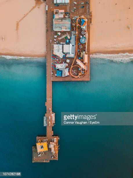 aerial view of pier by sea - santa monica stock pictures, royalty-free photos & images