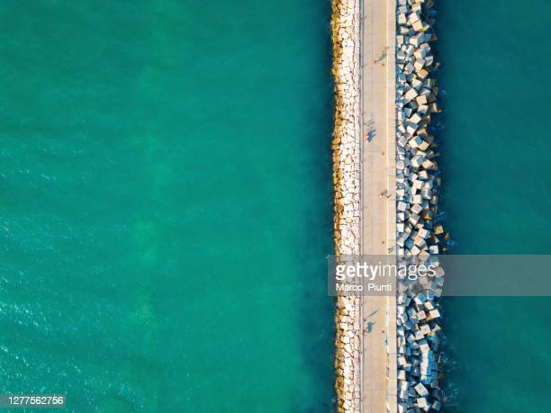 aerial view of pier from drone view - emerald green stock pictures, royalty-free photos & images