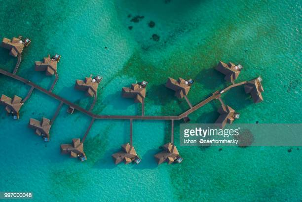 aerial view of pier houses - maldives stock pictures, royalty-free photos & images