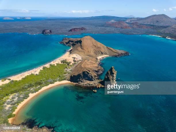aerial view of pinnacle rock, bartolome island, galapagos, ecuador - galapagos islands stock pictures, royalty-free photos & images