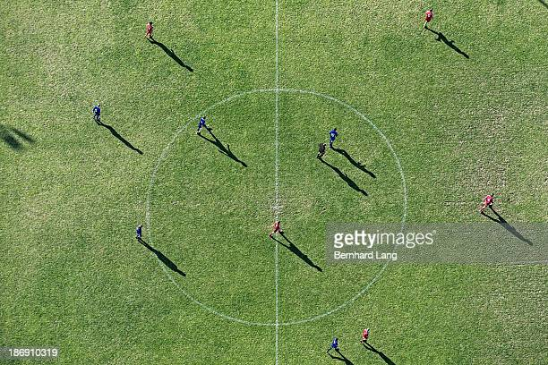 aerial view of players on football pitch - football pitch stock pictures, royalty-free photos & images